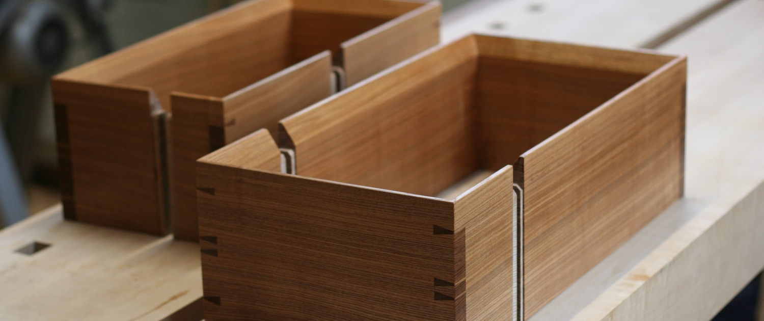 Hand cut dovetails on the corners of olive ash boxes
