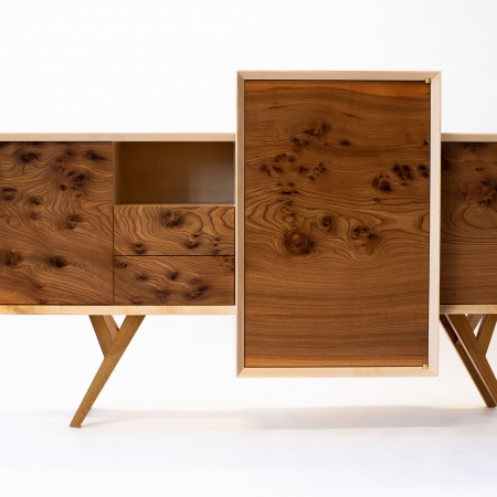 Front view of Elm Credenza with its offset and intersecting carcasses